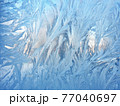 frosty patterns on the window glass. natural textures and backgrounds. ice patterns on frozen 77040697