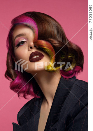 Beautiful woman with multi-colored hair and bright make up and hairstyle. 77055099