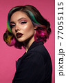 Beautiful woman with multi-colored hair and bright make up and hairstyle. 77055115