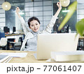 young asian business woman celebrating with arms raised in office 77061407