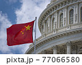 China flag waving on Washington DC Capitol dome detail with waving chinese flag 77066580