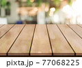 Empty wooden table top with lights bokeh on blur restaurant background. 77068225