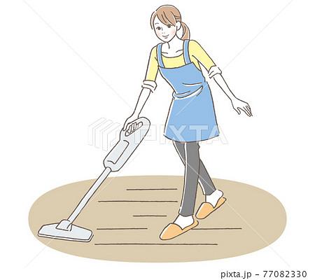 掃除機で部屋を掃除をする女性  77082330