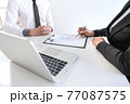 Employer or recruiter holding reading a resume during about colloquy his profile of candidate, employer in suit is conducting a job interview, manager resource employment and recruitment concept 77087575