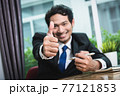 Business man smiling showing thumbs up 77121853