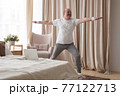 Elderly man practicing yoga or fitness. Positive mood on sports activities 77122713
