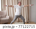Elderly man practicing yoga or fitness. Positive mood on sports activities 77122715