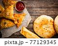 Samsa or samosas with meat 77129345