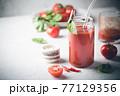 Glass of tomato juice 77129356