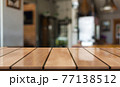 Empty wooden table top with lights bokeh on blur restaurant background 77138512