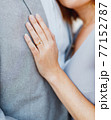 Bride put her hand on the chest of groom, hugging him 77152787