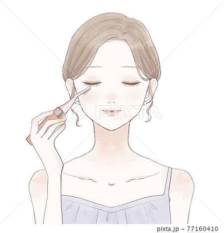 ホットビューラーでまつ毛をカールさせる女性 77160410
