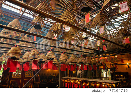 Incense Coils and interior of Man Mo temple, one of the famous tourist destination in Hong Kong, China. 77164716