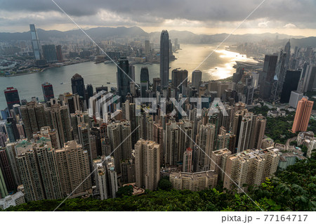 Skyscapers and cityscape of Hong Kong financial district from Victoria peak and sunrise. 77164717