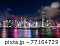 Hong Kong downtown skyline across Victoria harbor at night, Hong Kong, China. 77164729