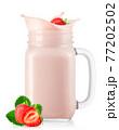 strawberry falling in mason jar of yogurt with splash 77202502