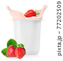 strawberry falling in plastic cup with yogurt 77202509