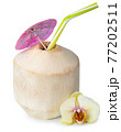 peeled coconut with straw on white background 77202511