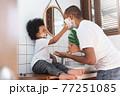 Cheerful African American Man and little boy having fun 77251085