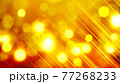 ゴールドカラーのキラキラ背景素材 77268233