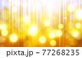 ゴールドカラーのキラキラ背景素材 77268235