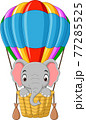 Cartoon baby elephant riding a hot air balloon 77285525
