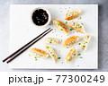 Jiaozi, Gyoza, Chinese fried dumplings served with soy sauce 77300249