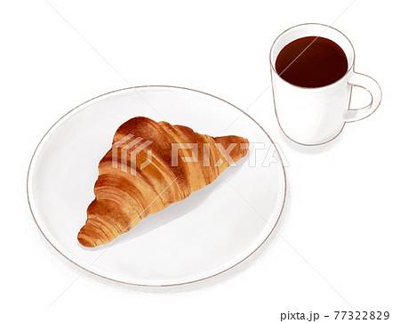 マグカップに入ったコーヒーとお皿に乗ったクロワッサン 77322829