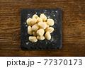 Raw gnocchi pasta on board 77370173