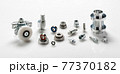 Selection of precision steel machine components on white 77370182