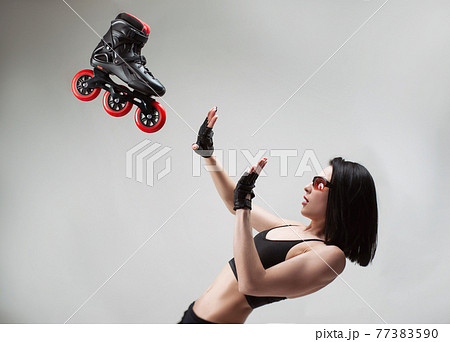 a woman protects her face from a roller skate flying at her 77383590