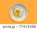 Dirty dish on orange background. Top view 77415086