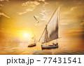 Sailboats at sunset 77431541