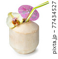 peeled coconut with straw on white background 77434527