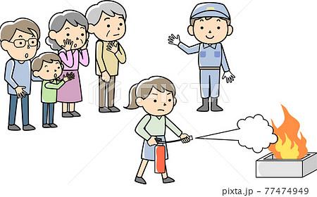 消火器を使っての消火訓練をする女性 77474949