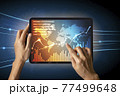 Close-up Of Business man's hand holding tablet showing stock market statistics gain profits and increase of chart positive indicators. Financial analysis, statistics. Concept of business strategy. 77499648