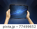 Close-up Of Business man's hand holding tablet showing stock market statistics gain profits and increase of chart positive indicators. Financial analysis, statistics. Concept of business strategy. 77499652
