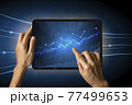 Close-up Of Business man's hand holding tablet showing stock market statistics gain profits and increase of chart positive indicators. Financial analysis, statistics. Concept of business strategy. 77499653