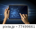 Close-up Of Business man's hand holding tablet showing stock market statistics gain profits and increase of chart positive indicators. Financial analysis, statistics. Concept of business strategy. 77499661