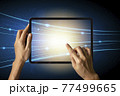 Close-up Of Business man's hand holding tablet showing stock market statistics gain profits and increase of chart positive indicators. Financial analysis, statistics. Concept of business strategy. 77499665