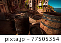 old wooden wine barrels in a sea town port 77505354