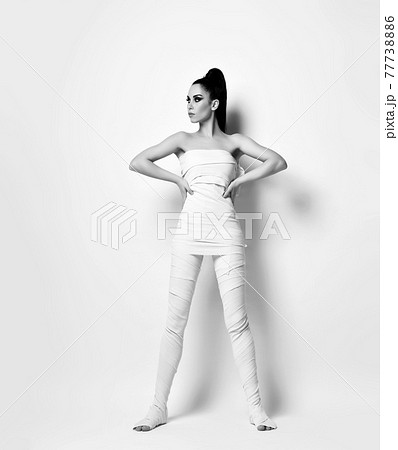 Young brunette woman in white medical bandages 77738886