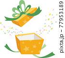黄色の星模様のギフトボックスを開ける。紙吹雪が箱から飛び出す。 77953189