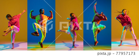 Young girl and man dancing hip-hop in bright attire on colorful background in neon light 77957173