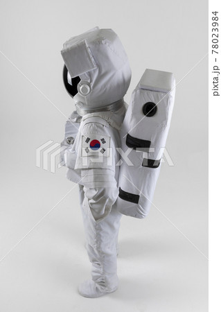 lively astronaut hands on the waist, white background 78023984