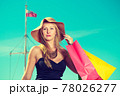Portrait of elegant woman with shopping bags 78026277