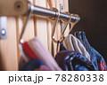 Kid's cloth hanginig on metal hooks. Close-up. 78280338