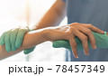 Surgeon, surgical doctor holding patient hand in professional ER emergency operation room for health care trust, medical anesthetic safety by anesthetist or anesthesiologist healthcare support concept 78457349