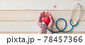 World heart health day concept with red heart and medical doctor stethoscope on aged woman hand support for medical wellness, life insurance and cardiological background 78457366