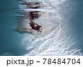 Beautiful woman swims underwater in the pool. 78484704